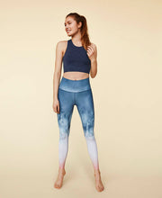 model standing in new elements leggings by moonchild yoga wear for aktiv scandinavian athleisure