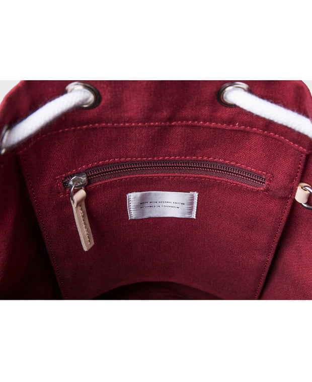 Stig Burgundy backpack interior with natural leather accents by Sandqvist in organic cotton