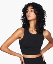 model posing in seamless crop top by moonchild yoga wear for aktiv scandinavian athleisure