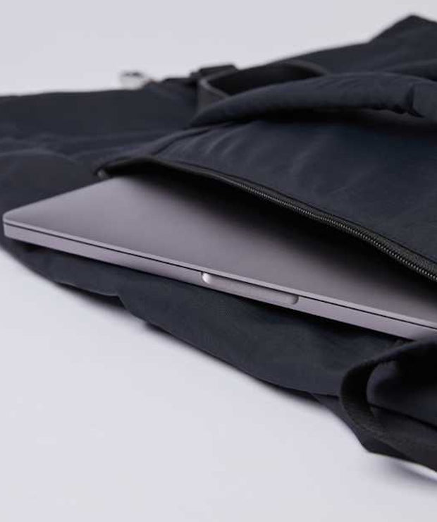 Laptop zipped compartment of Black rolltop Siv Backpack by Sandqvist of Sweden