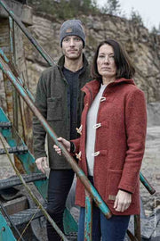 Man in forest green overshirt and woman in red duffel coat from Ivanhoe of Sweden