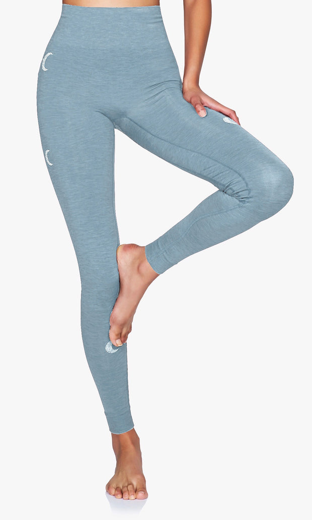 Solstice Seamless Legging with silver crescent moons in Citadel Blue on model