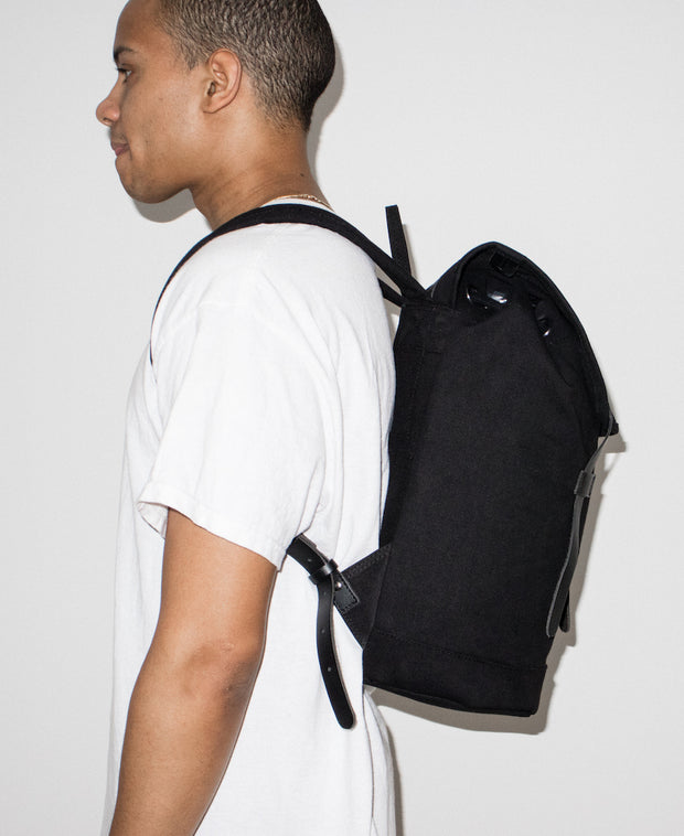 Stig black backpack with black leather accents by Sandqvist in organic cotton side view on Male Model