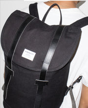 Stig black backpack with black leather accents by Sandqvist in organic cotton on Male Model