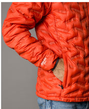 Men's Transform duck down puffy jacket in red clay by 8848 Altitude for Aktiv on Male model