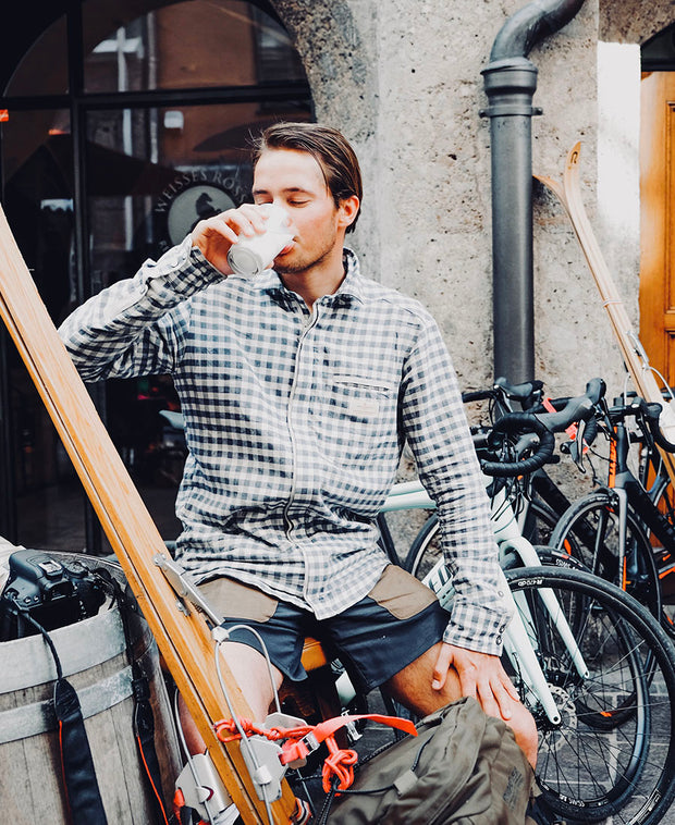model drinking in vagabond shirt mens amundsen sports for aktiv scandinavian outdoor wear