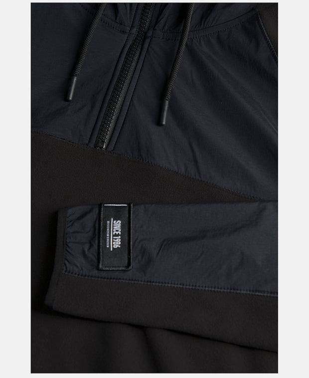 Detail of Women's black half zip hoodie by Peak Performance