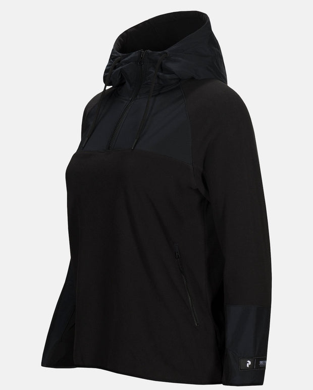 Side view of Women's black half zip hoodie by Peak Performance