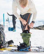 Model skiing in Ziplongs® 3/4 Microfleece Mens by Northern Playground for Aktiv Scandinavian Activewear