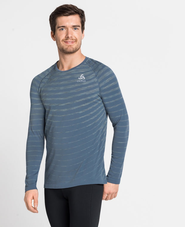 Man wearing a light blue crew neck long sleeve runners shirt by Odlo