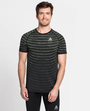 Runner wearing striped shirt by Odlo.