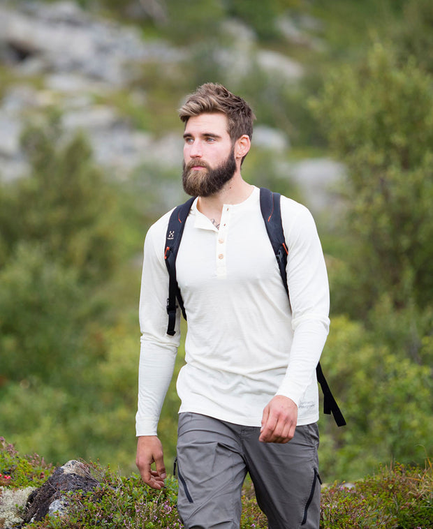 model hiking in organic wool & silk long sleeve shirt white black by northern playground for aktiv scandinavian outdoor wear