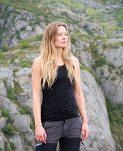model hiking in organic wool & silk tank top womens black by northern playground for aktiv scandinavian outdoor wear