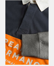 Details of blue and orange rugby shirt