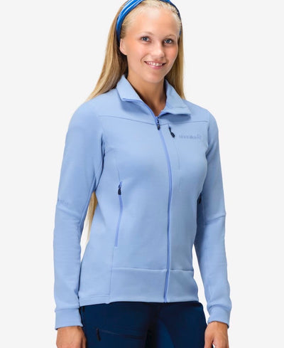 Woman wearing a light blue zip jacket by Norrona