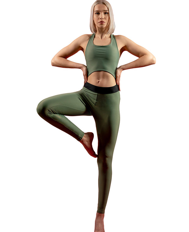 Front view of woman wearing olive green VanillaShanti one-piece yoga bodysuit or unitard
