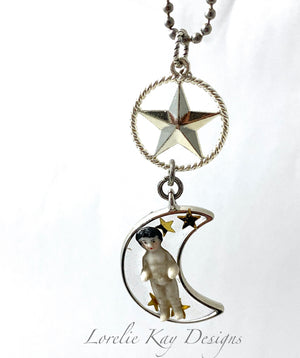 Frozen Charlotte Doll Necklace Swinging On A Star Moon & Stars Pendant