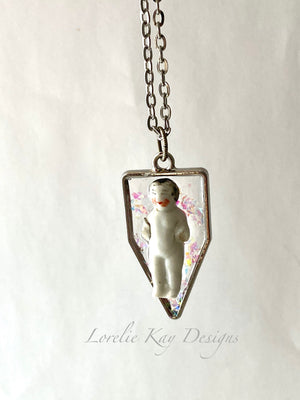 Frozen Charlotte Dark Hair Doll Necklace Cast Resin