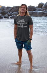 Man standing on beach wearing a I Just Want To Smoke Weed And Fish All Day T-Shirt - Magic Leaf tees