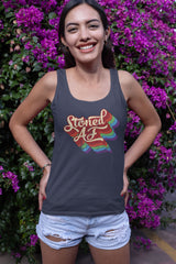 Smiling woman wearing a Stoned AF weed tank top - Magic Leaf Tees