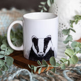 white ceramic mug with blank ink badger printed, can be personalised on reverse