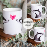 white ceramic mug printed with 2 badgers facing one another with a heart in the middle