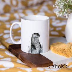 white ceramic mug printed with black ink otter drawing and can be personalised on the reverse