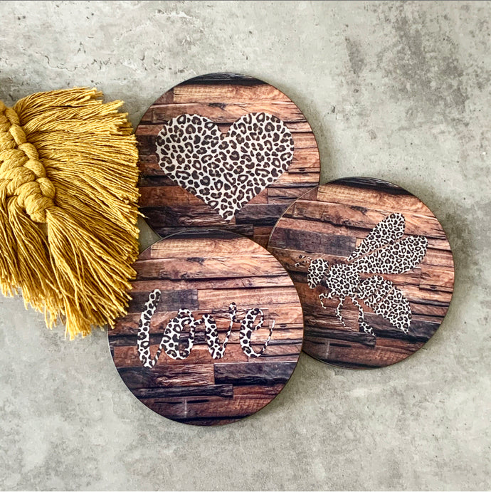 9cm round mdf coaster printed with a wood effect background and choice of leopard print icons to be printed in the middle, ie heart, the word love, a bee etc