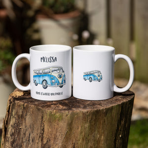 "pair of ceramic mugs showing front and back design, large watercolour campervan on the front with name above and ""home is where you park it"" underneath and the rear mug shows a smaller campervan printed"