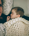 baby sleeping with mother