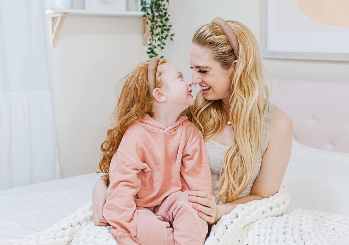 mother and daughter smiling each other