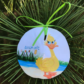 FLIRTY DUCK SAND DOLLAR ORNAMENT