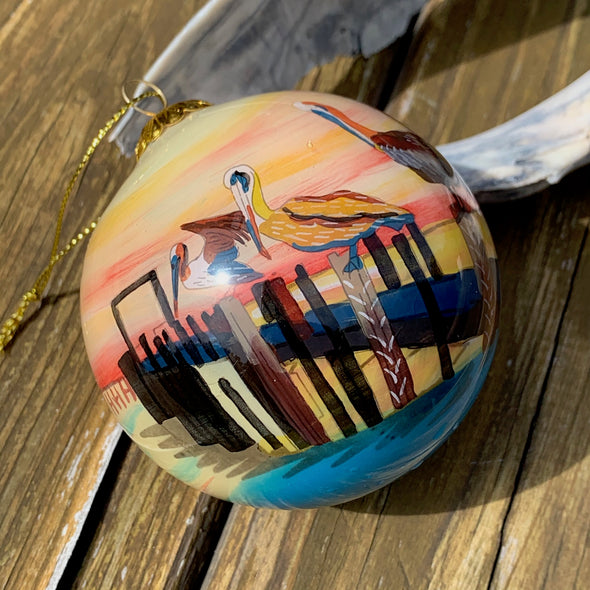 OUTER BANKS PELICANS PAINTED GLASS ORNAMENT