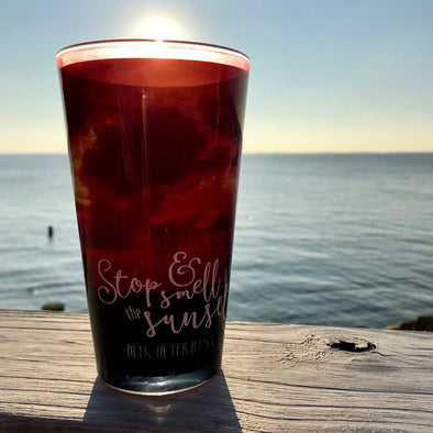 STOP & SMELL THE SUNSET PINT GLASS