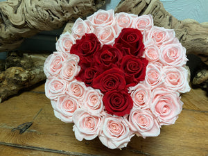 Pink Preserved Roses with Center formed with Red Roses in Pink Hat Box