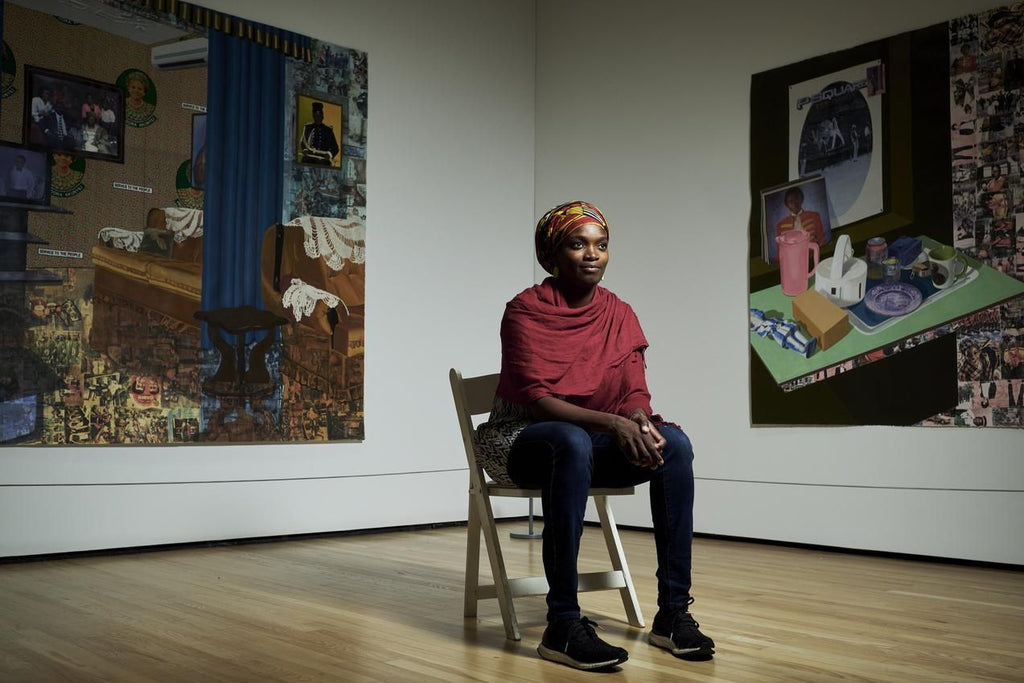 Image of Njideka Akunyili Crosby at the Baltimore Museum of Art with her work.