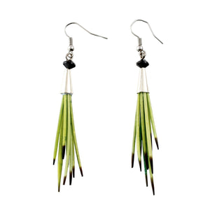 Green porcupine quill earrings on isolate white backdrop