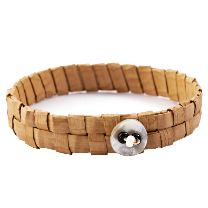 One woven cedar bark bracelets on isolated white backdrop