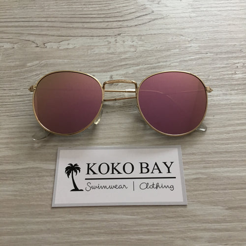 Round sunglasses in rose gold