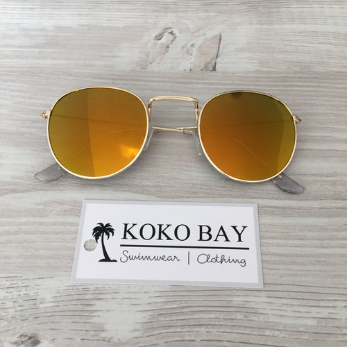 Round sunglasses in orange/gold