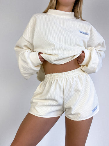 Oversized cord jumper in cream