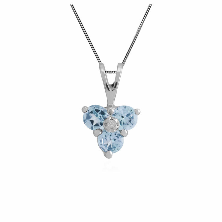 Blue topaz and diamond trilogy pendant in white gold