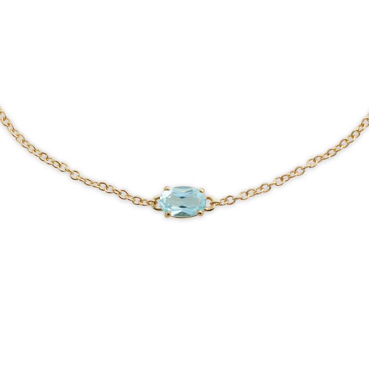 Classic Oval Blue Topaz Single Stone Bracelet in 9ct Yellow Gold