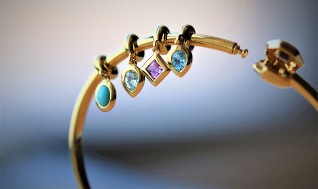 Achievement 'Stone of Rebirth' Gold Plated Blue Topaz Charm