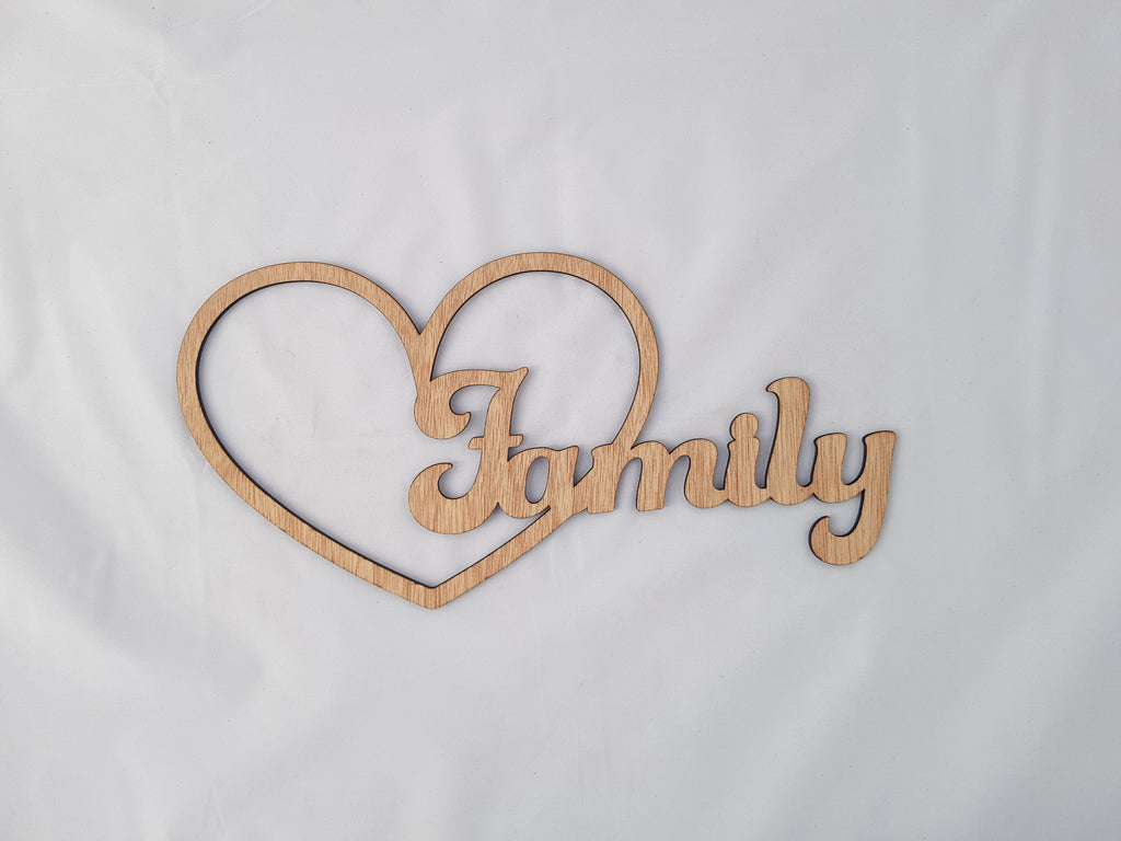 Family in love heart, carved of wood - TroubleMaker.co.nz