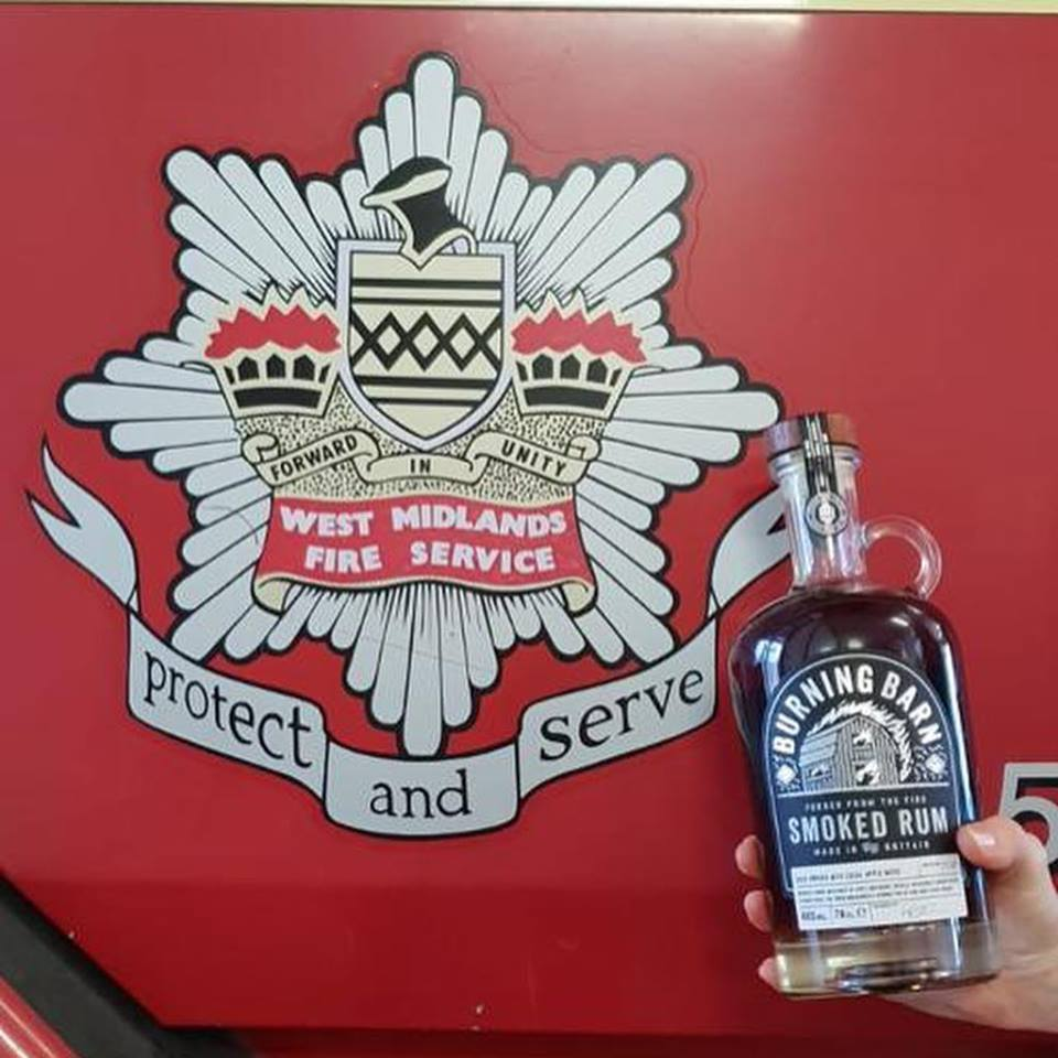 Fire service red logo and with hand holding smoked rum bottle