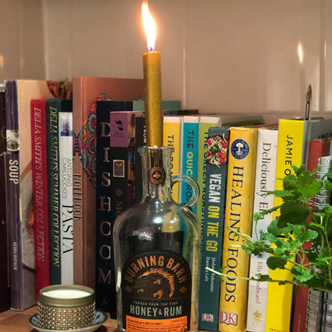 BBR bottle with lit candle in neck