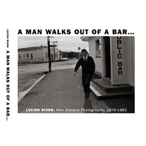 A Man Walks Out Of A Bar