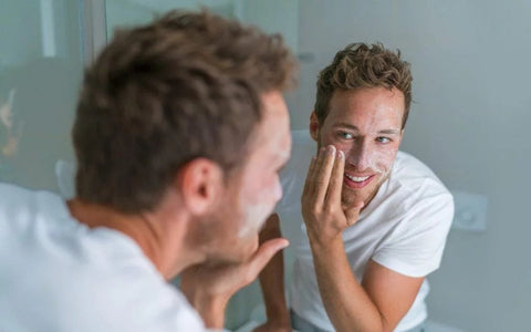 Man Apply Face Scrub to Face