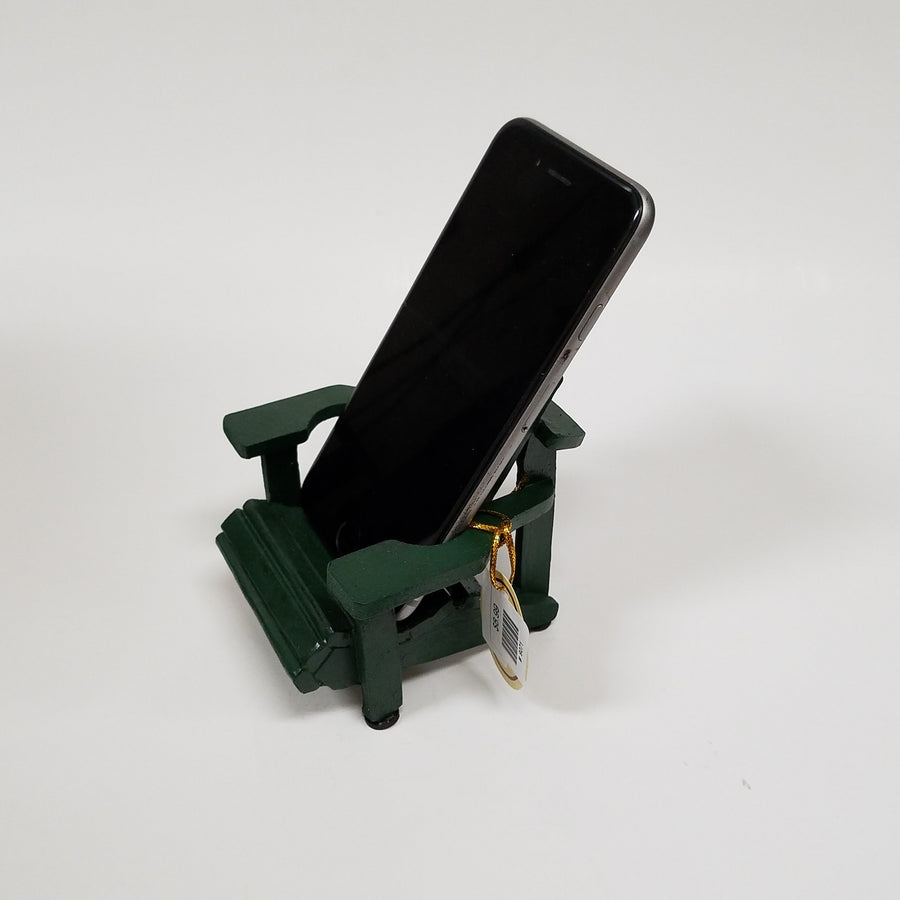 Iphone resting diagonally in mini green Adirondack chair